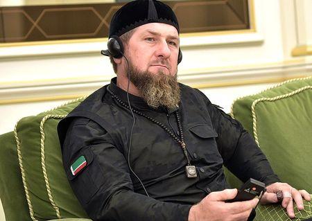 Кто это бородатый рядом с Путиным?